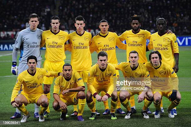 Arsenal team players pose before the UEFA Champions League round of 16 first leg match AC Milan vs Arsenal at San Siro stadium on February 15 2012 in...