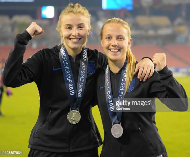 Arsenal teammates Beth Mead and Leah Williamson of England with their medals during the SheBelieves Cup Ceremony at Raymond James Stadium on March 5...