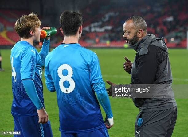 Arsenal U18 Manager Kwame Ampadu talks to Matthew Smith and Robbie Burton before the start of extra time during the FA Youth Cup 4th Round match...