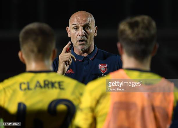 Arsenal U21 Manager Steve Bould talks to his players before the penalty shoot out after the Leasingcom match between Northampton Town and Arsenal U21...
