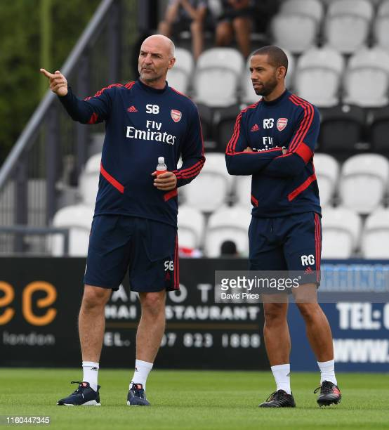 Arsenal U23 Manager Steve Bould and his assistant Ryan Garry before the PreSeason Friendly match between Boreham Wood and Arsenal XI at Meadow Park...