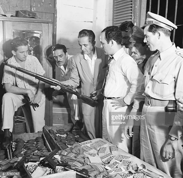 Arsenal Uncovered in Cuban Raid Havana Cuba Cuban secret service men are examining part of the arsenal discovered in a raid on the home of Benito...