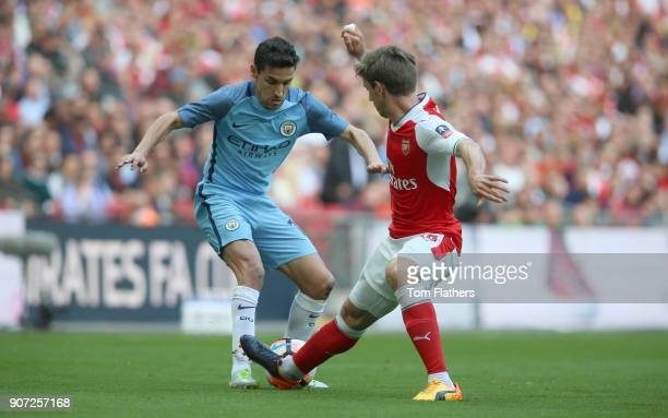 Arsenal v Manchester City Emirates FA Cup Semi Final Wembley Stadium Manchester City's Jesus Navas and Arsenal's Aaron Ramsey battle for the ball
