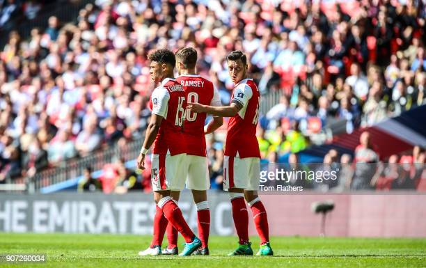 Arsenal v Manchester City Emirates FA Cup Semi Final Wembley Stadium Arsenal's Alex OxladeChamberlain Aaron Ramsey and Mesut Ozil in action against...