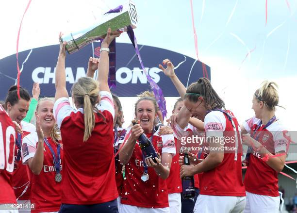 Arsenal Women celebrate winning the league as Jordan Nobbs holds the trophy aloft during the Women's Super League match between Arsenal Women and...