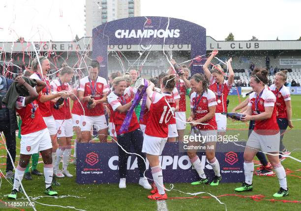 Arsenal women celebrate winning the Women's Super League after the WSL match between Arsenal Women and Manchester City at Meadow Park on May 11 2019...