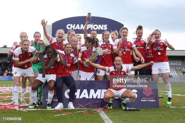 Arsenal Women celebrate with the trophy during the Women's Super League match between Arsenal Women and Manchester City Women at Meadow Park on May...