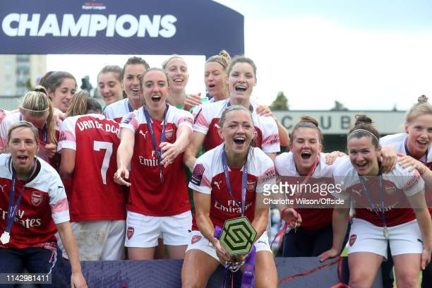 Arsenal Women celebrate with the trophy led by Katie McCabe during the Women's Super League match between Arsenal Women and Manchester City Women at...