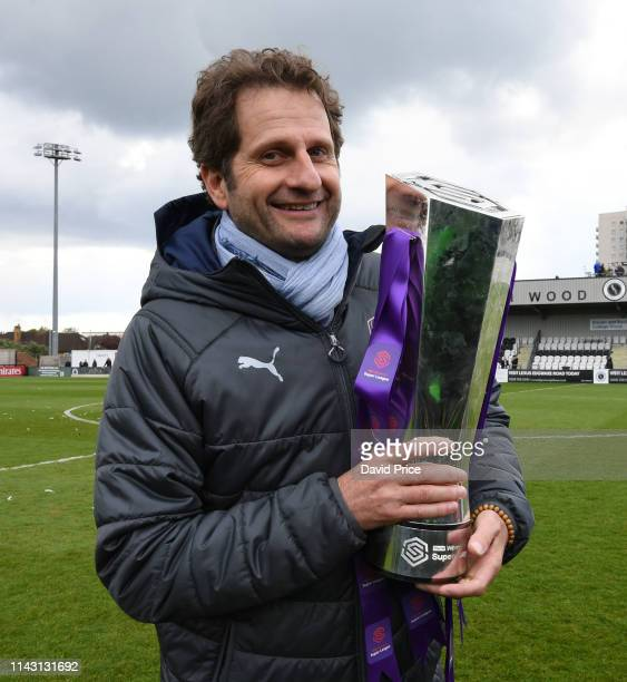 Arsenal Women Manager Joe Montemurro with the WSL Trophy after the match between Arsenal Women and Manchester City Women at Meadow Park on May 11,...