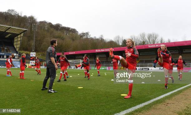 Arsenal Women warm up before the match between Reading FC Women and Arsenal Women at Adams Park on January 28 2018 in High Wycombe England