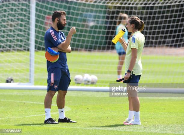 Arsenal Women's Assistant Manager Aaron D'Antino chats to Lisa Evans of Arsenal during the Arsenal Women training session at Arsenal Academy on July...