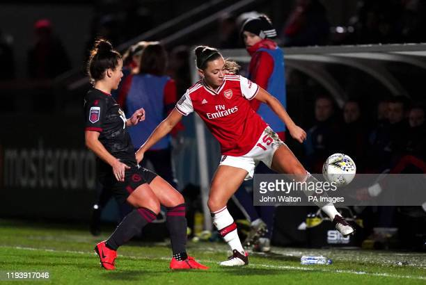 Arsenal Women's Katie McCabe and Reading Women's Angharad James battle for the ball during the Continental Cup quarter final match at Meadow Park...
