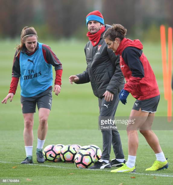 Arsenal Women's Manager Joe Montemurro with Heather O'Reilly and Jemma Rose during the Arsenal Womens Training Session at London Colney on November...