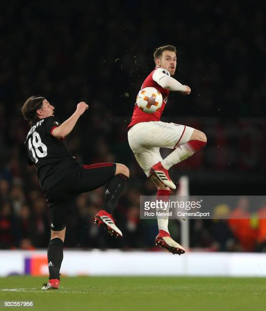 Arsenal's Aaron Ramsey and AC Milan's Riccardo Montolivo during the Europa League Round of 16 Second Leg match between Arsenal and AC Milan at...