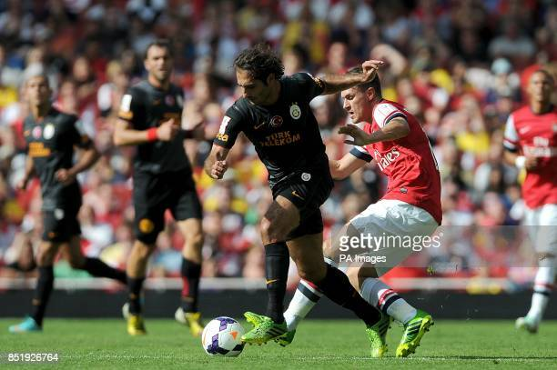 Arsenal's Aaron Ramsey and Galatasaray's Hamit Altintop battle for the ball