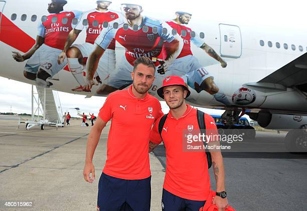 Arsenal's Aaron Ramsey and Jack Wilshere in front of the Emirates plane as they travel to Singapore for the Barclays Asia Trophy at Stansted Airport...