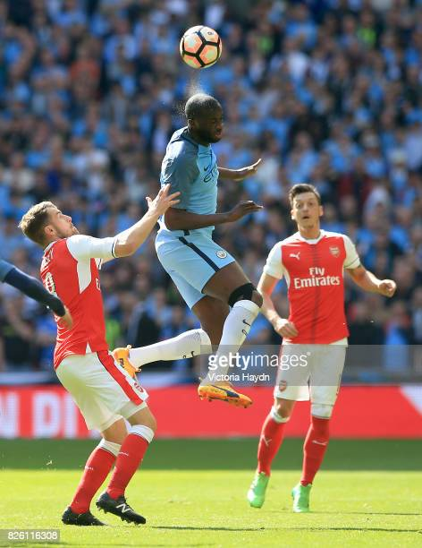 Arsenal's Aaron Ramsey and Manchester City's Yaya Toure battle for the ball