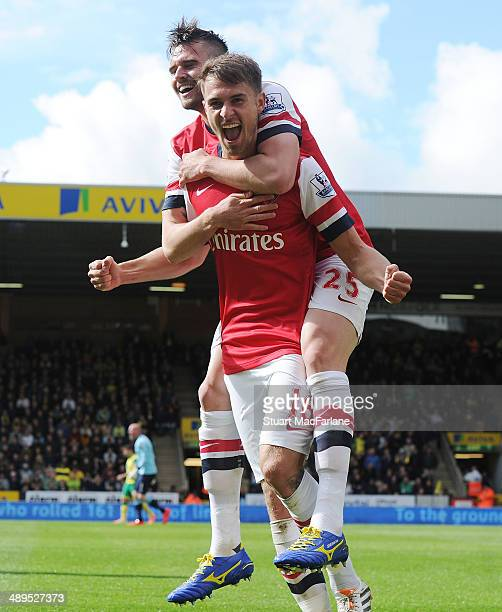 Arsenal's Aaron Ramsey celebrates his goal with Carl Jenkinson during the Barclays Premier League match between Norwich City and Arsenal at Carrow...
