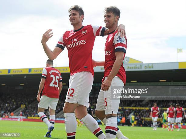 Arsenal's Aaron Ramsey celebrates his goal with Olivier Giroud during the Barclays Premier League match between Norwich City and Arsenal at Carrow...