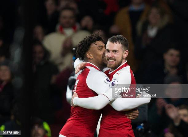 Arsenal's Aaron Ramsey celebrates scoring his side's fifth goal with team mate Alex Iwobi during the Premier League match between Arsenal and Everton...