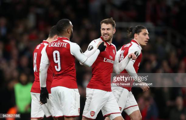Arsenal's Aaron Ramsey celebrates scoring his side's first goal with Alexandre Lacazette during the UEFA Europa League quarter final leg one match...