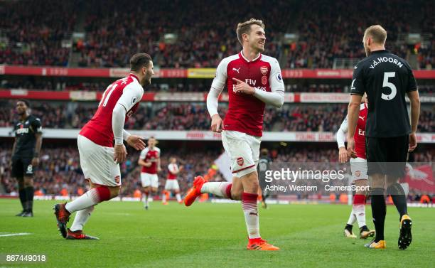 Arsenal's Aaron Ramsey celebrates scoring his side's second goal during the Premier League match between Arsenal and Swansea City at Emirates Stadium...