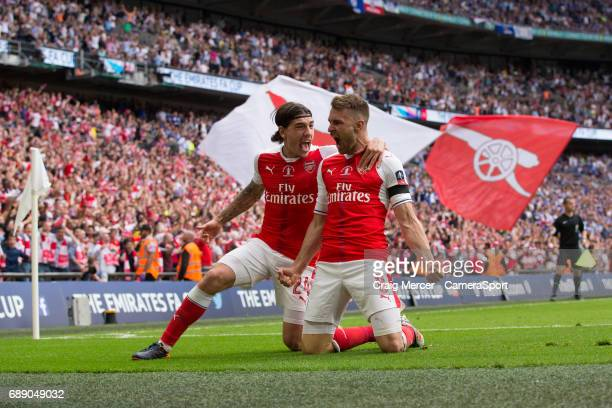 Arsenal's Aaron Ramsey celebrates scoring his sides second goal with team mate Hector Bellerin during the Emirates FA Cup Final match between Arsenal...