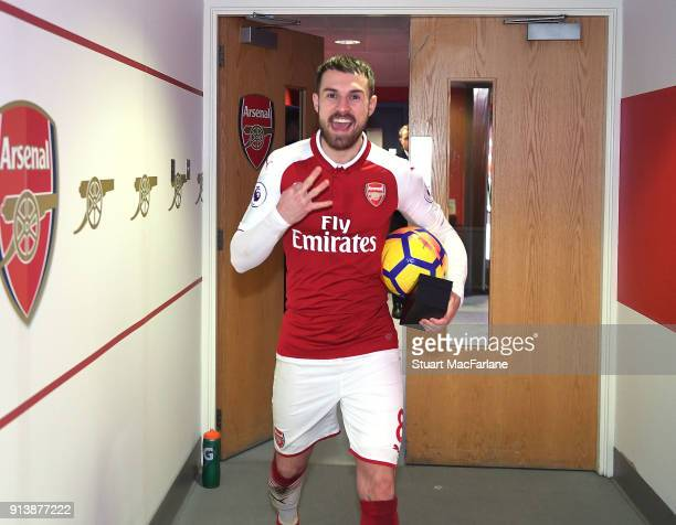 Arsenal's Aaron Ramsey in the changing room with the match ball after scoring a hat trick after the the Premier League match between Arsenal and...