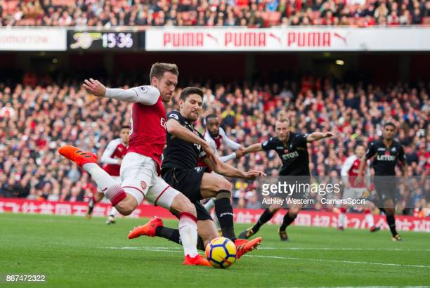 Arsenal's Aaron Ramsey is tackled by Swansea City's Federico Fernandez during the Premier League match between Arsenal and Swansea City at Emirates...