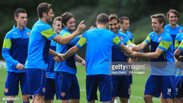Arsenal's Aaron Ramsey jokes with Olivier Giroud Tomas Rosicky Mathieu Flamini and Nacho Monreal who all flick Ramsey's ears during a training...