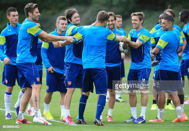 Arsenal's Aaron Ramsey laughs with team mates including Olivier Giroud Tomas Rosicky and Nacho Monreal during a training session at London Colney...