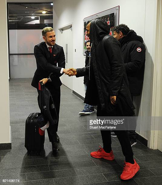Arsenal's Aaron Ramsey with ex player Thierry Henry in the players entrance before the Premier League match between Arsenal and Tottenham Hotspur at...