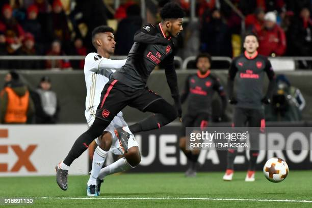 Arsenal's Ainsley MaitlandNiles and Ostersund's Tesfaldet Tekie vie for the ball during the UEFA Europa League round of 32 first leg football match...