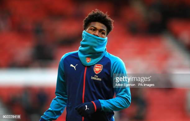 Arsenal's Ainsley MaitlandNiles warms up during the Emirates FA Cup Third Round match at the City Ground Nottingham