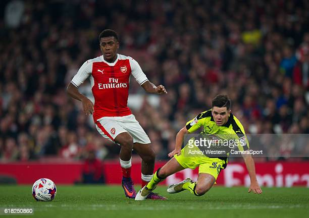 Arsenal's Alex Iwobi battles for possession with Reading's Liam Kelly during the EFL Cup 4th Round match between Arsenal and Reading at Emirates...