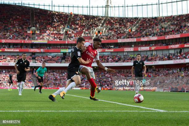 Arsenal's Alex Iwobi holds off the challenge from Sevilla's Sebastien Corchia during the Emirates Cup match between Arsenal and Sevilla FC at...