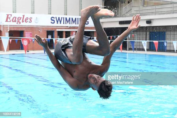 Arsenal's Alex Iwobi jumps inot the pool after a training session at Singapore American School on July 24 2018 in Singapore