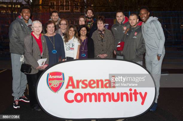 Arsenal's Alex Iwobi Mathieu Debuchy David Ospina Jack Wilshere and Danny Welbeck visit the Blessed Sacrament Primary School on December 5 2017 in...