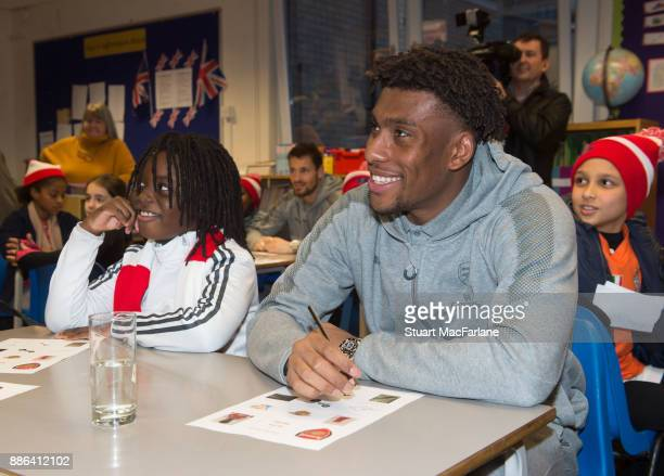 Arsenal's Alex Iwobi visits the Blessed Sacrament Primary School on December 5 2017 in London England