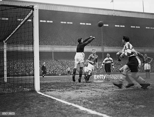 Arsenal's Alex James watches Ellis the Barnsley keeper during an FA Cup quarter final tie at Highbury London 29th February 1936 Arsenal eventually...