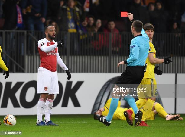 Arsenal's Alex Lacazette is sent off by referee Srdjan Jovanovic during the UEFA Europa League Round of 32 First Leg match between BATE Borisov and...