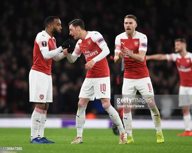 Arsenal's Alex Lacazette Mesut Ozil and Aaron Ramsey during the UEFA Europa League Round of 16 Second Leg match between Arsenal and Stade Rennais at...