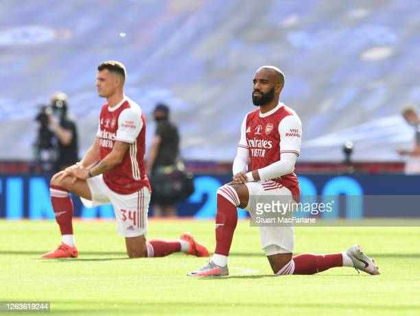 Arsenal's Alex Lacazette 'takes a knee' before the FA Cup Final match between Arsenal and Chelsea at Wembley Stadium on August 01 2020 in London...