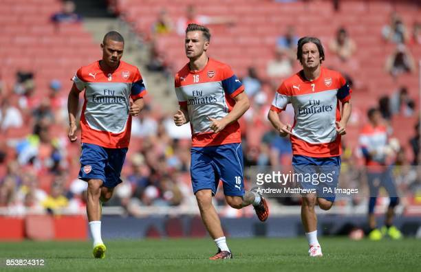 Arsenal's Alex OxladeChamberlain Aaron Ramsey and Tomas Rosicky during the training session at the Emirates Stadium London