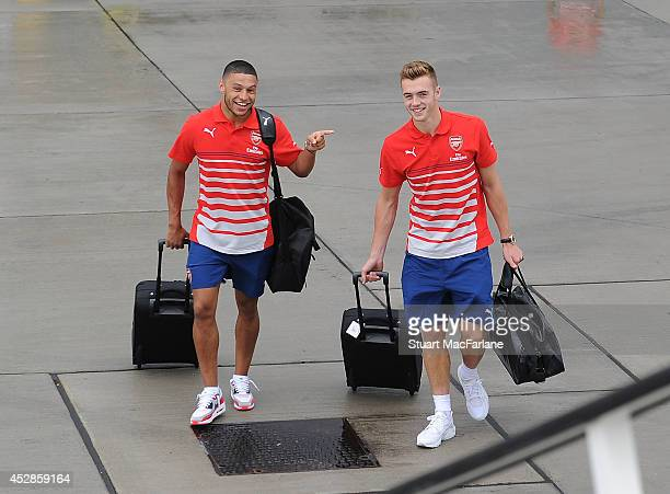 Arsenal's Alex OxladeChamberlain and Calum Chambers board the team flight for Austria at Luton Airport on July 28 2014 in Luton England