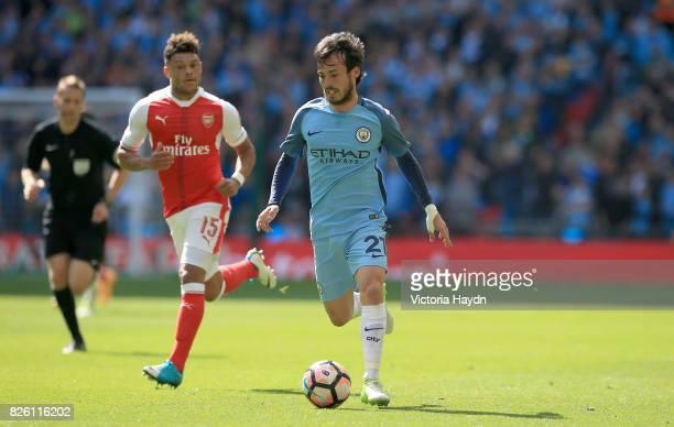 Arsenal's Alex OxladeChamberlain and Manchester City's David Silva battle for the ball