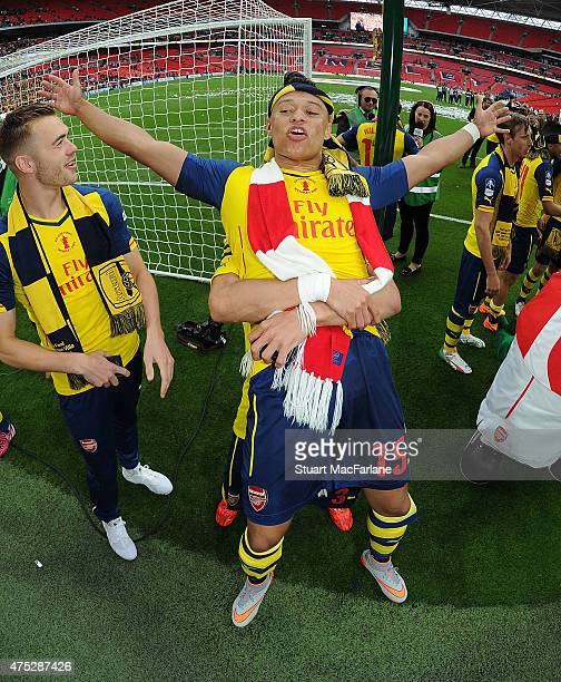 Arsenal's Alex OxladeChamberlain celebrates after the FA Cup Final between Aston Villa and Arsenal at Wembley Stadium on May 30 2015 in London England