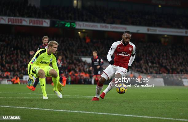 Arsenal's Alexandre Lacazette goes past Huddersfield Town's Jonas Lossl during the Premier League match between Arsenal and Huddersfield Town at...