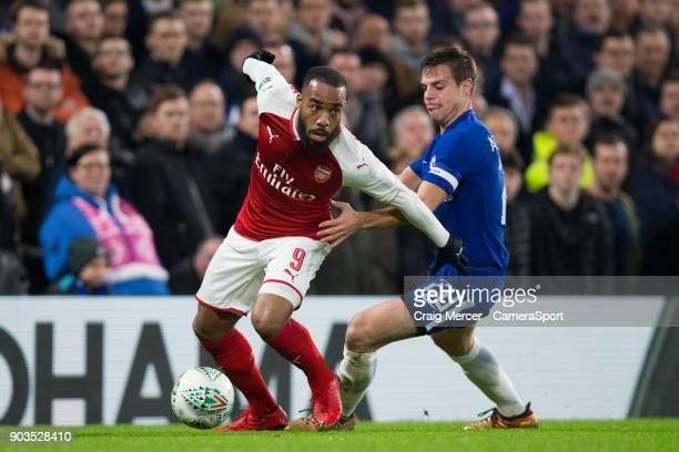 Arsenal's Alexandre Lacazette holds off the challenge from Chelsea's Cesar Azpilicueta during the Carabao Cup SemiFinal First Leg match between...