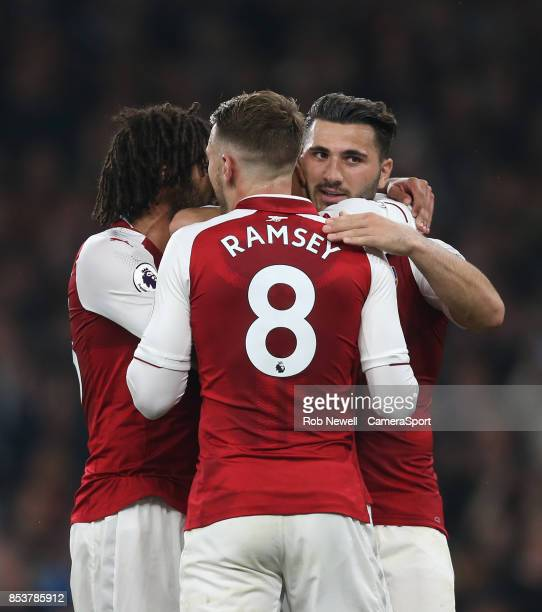 Arsenal's Alexandre Lacazette is congratulated after scoring his sides second goal during the Premier League match between Arsenal and West Bromwich...